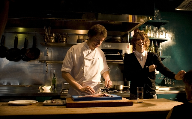 Razorlight's Johnny Borrell with chef Oliver Rowe preparing locally-sourced food at his restaurant Konstam. Copyright: Balthazar Serreau/Friends of the Earth