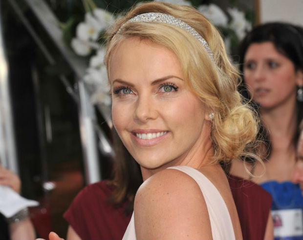 Charlize Theron organizes Charity Buzz auction to raise money for the fight against AIDS in Africa