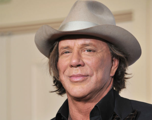 Mickey Rourke adopts stray dog found on movie set