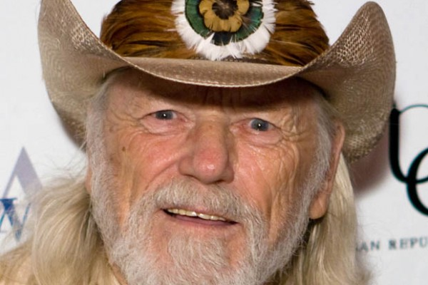 Willie Nelson receives Planet Defender Award for his philanthropy.
