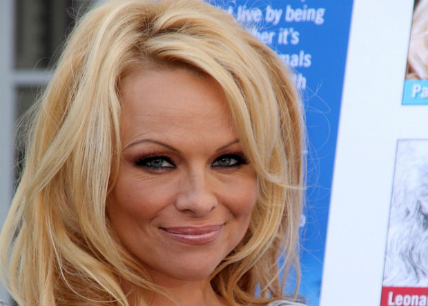 Pamela Anderson backs U.K. charity Cool Earth to help preserve rainforests