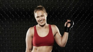 Ronda Rousey is an Olympic vegetarian and is now a world record holding MMA fighter.