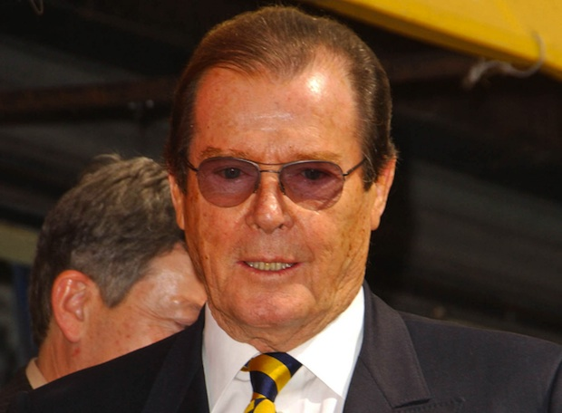Roger Moore has denounced the development of a pig farm in England.