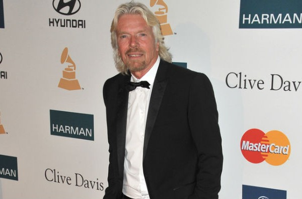 Richard Branson swims with endangered tiger sharks for animal conservation