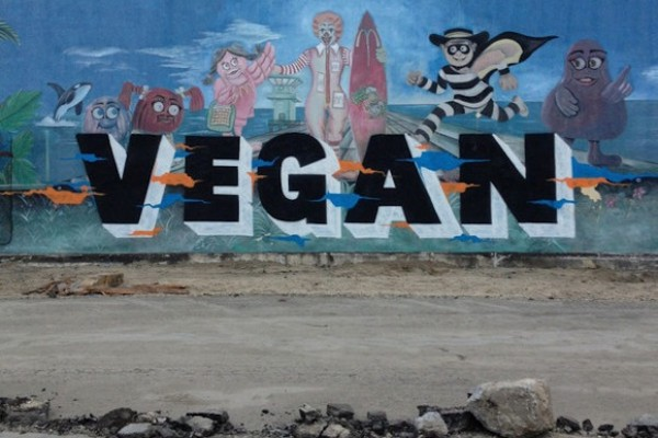"The McDonald's mural in Huntington Beach was untouched by vandals for 20 years, until it was tagged with the word ""vegan."""