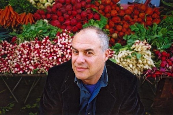 Mark Bittman's health strategy is to stick to a vegan diet before 6:00 PM every day.