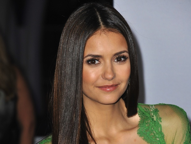 Nina Dobrev stays fit and healthy with yoga and a vegan diet.