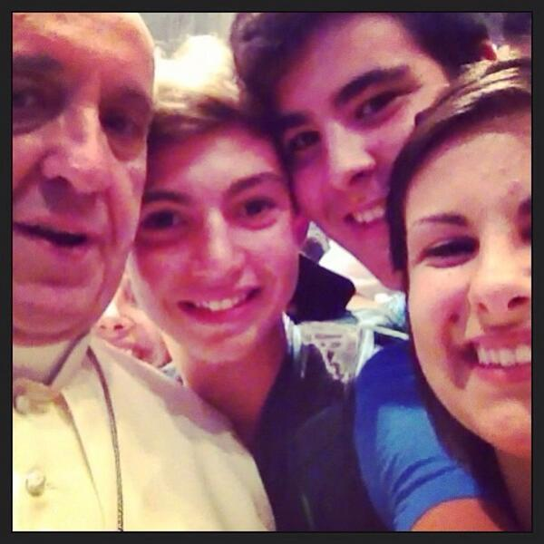Pope Francis poses with Catholic teens in Italy.